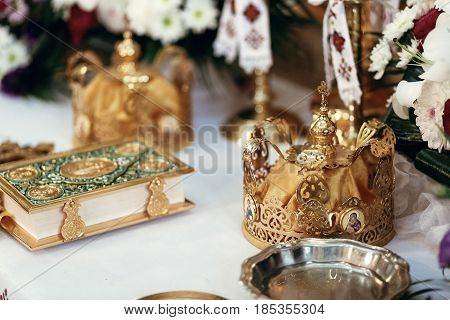 Golden Crowns And Holy Bible On Altar In Church At Wedding Ceremony, Spiritual Place, Religious Mome