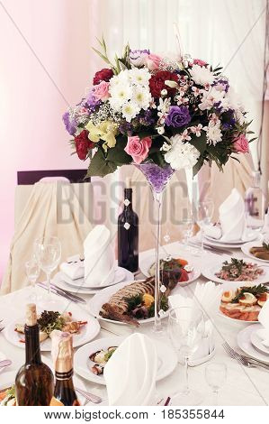 Beautiful Rustic Bouquets Flowers In Vases At Wedding Tables With Food In Restaurant, Luxury Wedding