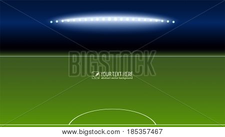 Green soccer field from the goalkeeper area with the spotlights with copy-space for your text or message. Lighted football field, horizontal image with aspect HD video.