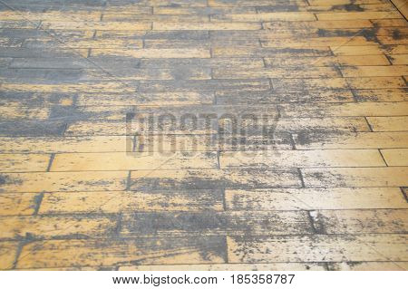 On the photo old wooden shabby parquet floor