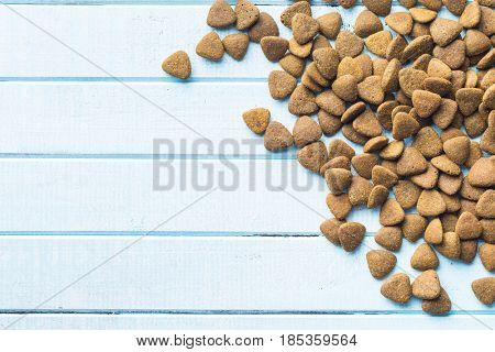 Dry kibble dog food on table. Top view.