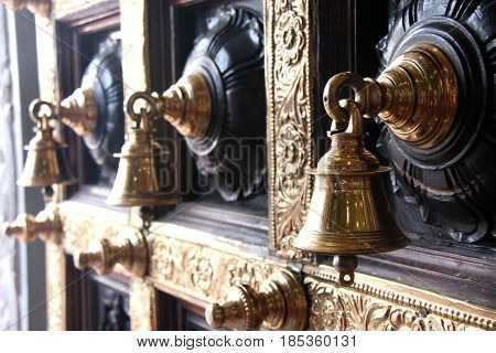 Bells adorn the door of a Chinese temple