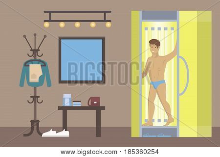 Man in solarium. Beauty salon and spa treatment. Man with bronze skin in cabinet.