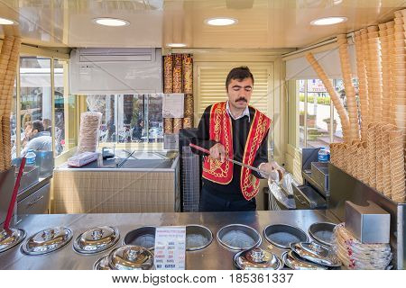ISTANBUL-APRIL 08: An ice cream seller, dressed in traditional Turkish costume, drums up customers. Istanbul is one of the most popular destinations in the world. On April 08, 2015 in Istanbul, Turkey