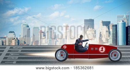 Businessman riding vintage roadster in motivation concept