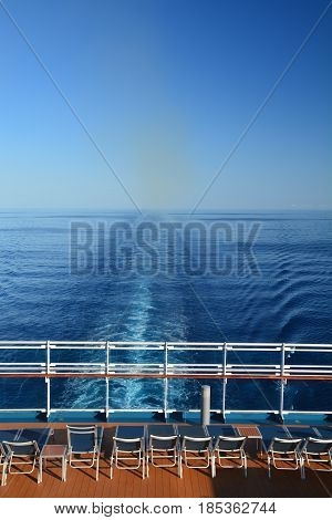The stern of cruise ship. Sunbeds with sea view
