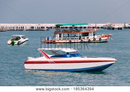 Sideview Bowrider Boat in Gulf of Thailand with Fishing Boat and Another Bowrider in the Background