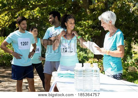 Athletes registering themselves for marathon in the park