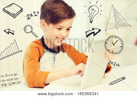 leisure, children, technology and people concept - smiling boy with tablet pc computer at home over mathematical doodles