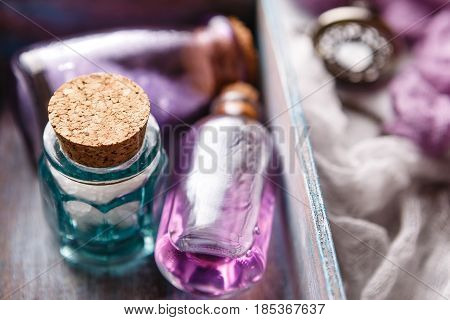 Bottle with aromatic lavender oil and sea salt in a wooden box. Close-up. Selective focus. Spa and perfume theme
