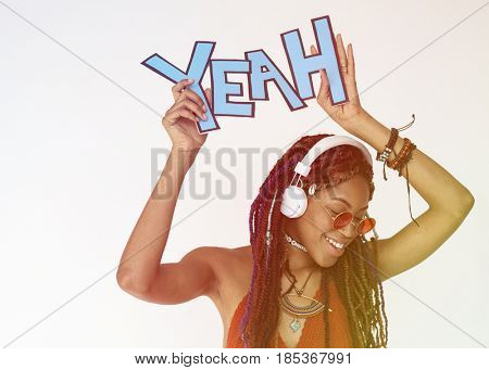 African woman smiling and holding papercraft with the word yeah