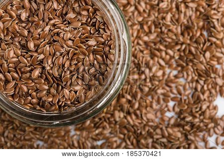 Close Up Of Flax Seeds Isolated On White Background. Bowl Full Of Brown Flaxseed Or Linseed. Cereals