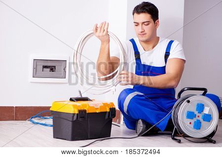 Man doing electrical repairs at home