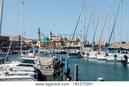 Acre Israel - April 20 2017 : View from the marina of the old city of Acre and its marina in Israel