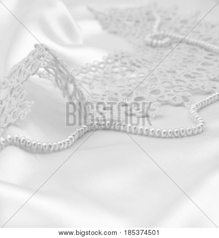Smooth Elegant White Silk Or Satin With Pearls And Lace As Wedding Background. In Black And White To
