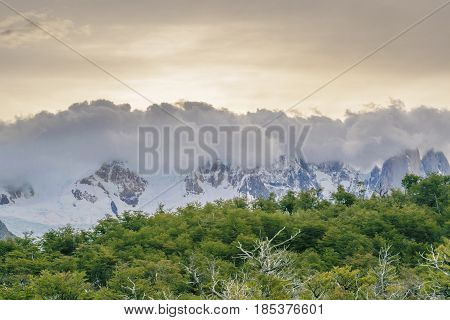 Overcast weather wit big clouds covering snowy andes mountains at El Chalten Argentina