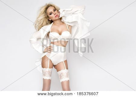 Elegant Female Model In White Sexy Wedding Lingerie And Silk Shirt Standing On White Background And