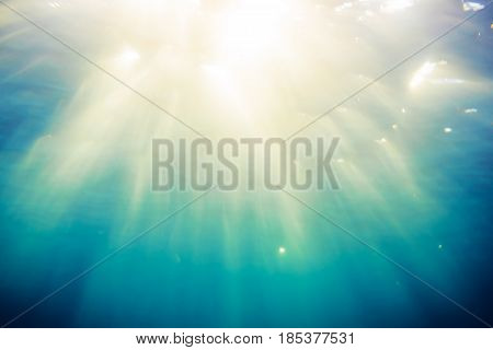 Texture of blue water in tropical ocean and sunlight. Underwater blue background