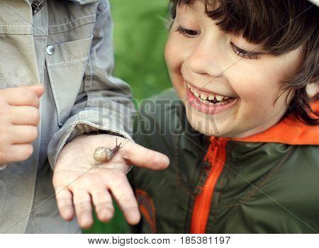 children learn snail, focus on boy