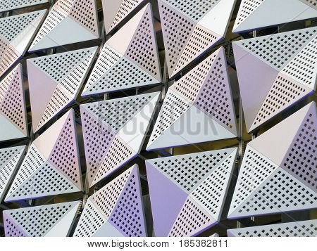 metal geometric triangular cladding on a generic modern building