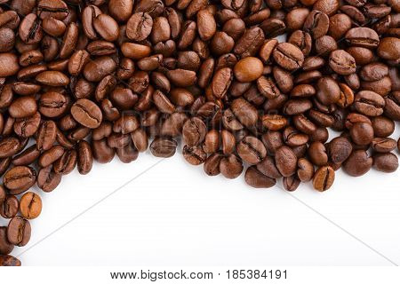 Roasted Coffee Beans Isolated In White Background. Roasted Coffee Beans Background Close Up. Coffee