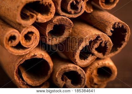 Cinnamon Sticks And Meal Close Up On Wooden Table. Cinnamon Sticks Spice Close Up Background. Textur