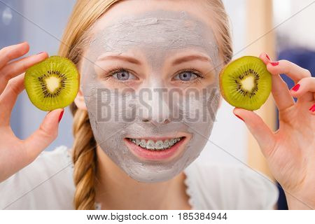 Happy Young Woman Having Face Mask Holding Kiwi