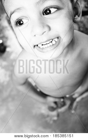 Little south asian boy portrait smilling and looking into the camera