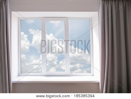 White metal-plastic window in modern apartment