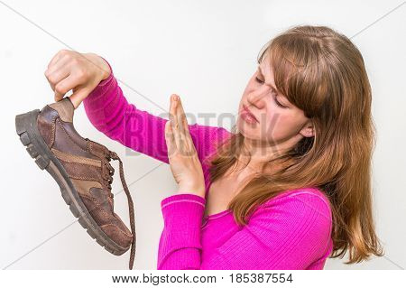 Woman Holding Dirty Stinky Shoes