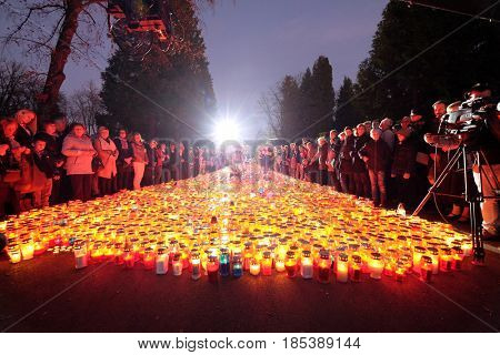 ZAGREB, CROATIA - NOVEMBER 01, 2016: Zagreb cemetery Mirogoj on All Saints Day visited by thousands of people light candles for their deceased family members.