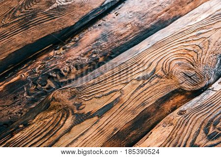 Background of textured burned pine wood boards