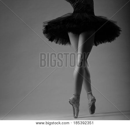 Unrecognizable Ballerina In Studio, Black Tutu Outfit. Long Legs, Black And White Image