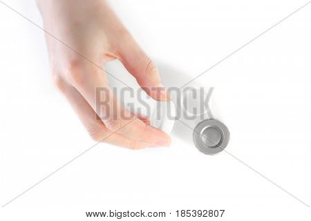 Woman with case for contact lenses on white background