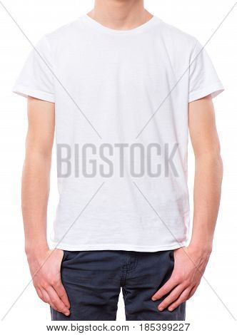 White t-shirt on teen boy. Close-up of front tshirt, isolated on a white background. Concept of childhood and fashion or advertisement design. Mock up template for design print.