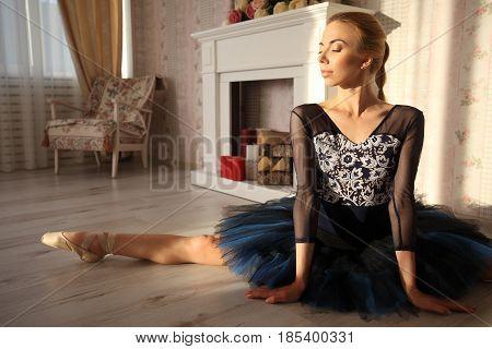 Ballerina Stretching Warming Up In Home Interior, Split On Floor