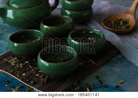 Green tea in traditional green Chinese cups