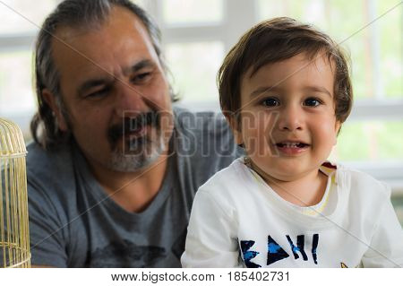 Eskisehir, Turkey - May 05, 2017: Sweet Little Boy With His Father Behind In Kindergarten Classroom