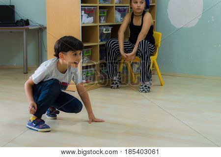Eskisehir, Turkey - May 05, 2017: Little Boy Playing On The Ground In Kindergarten Classroom