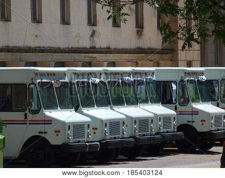 Dallas,USA, 07th May 2017. Mail trucks lineup at the downtown post office. The architecture of the building tells a history of mail delivery in the central business district location.
