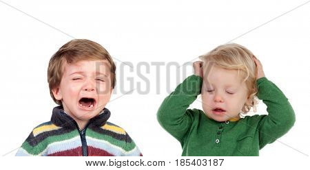 Little child crying and another covering his ears tired of hearing the crying isolated on white background