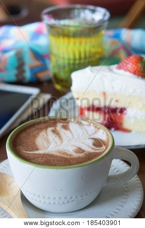 coffee cup and strawberry cake in coffee shop coffee relax time
