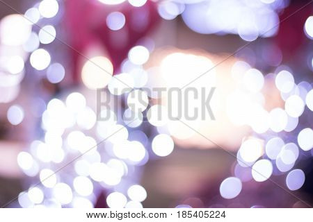 defocused bokeh lightsAbstract circular bokeh background; Festive Background With Natural Bokeh And Bright Golden Lights. Vintage Magic Background With Color Festive background with natural bokeh and bright golden lights. Vintage Magic background with col