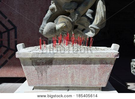 Burning of red incense sticks at chinese temple