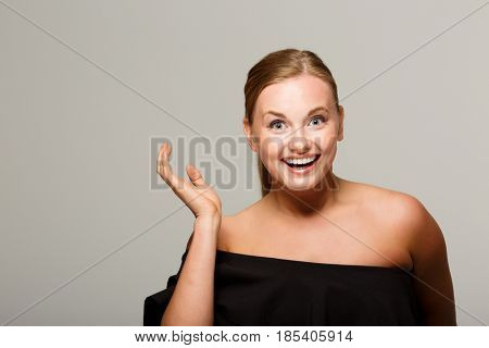 Smiling model with bare shoulders
