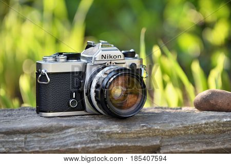 VILNIUS - MAY 8: Nikon vintage film camera with Nikkor 35mm lens on May 8 2017 in Vilnius Lithuania. Nikon Corporation specializing in optics and imaging products.