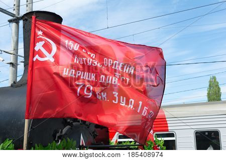 SARATOV RUSSIA - MAY 6 2017: Fragment of an old military locomotive with a red flag division. Mobile museum of the Great Patriotic War.