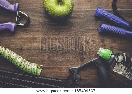 different fitness and street workout objects. fitness objects on the table. fitness and street workout concept. fitness objects on brown wooden table with copy space