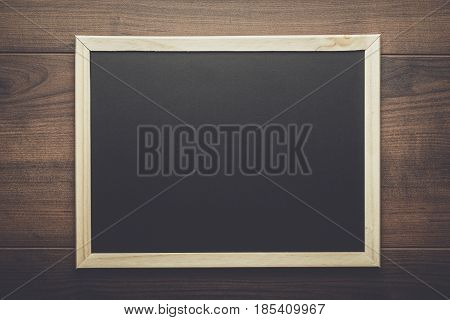 clean school blackboard. clean school on the wooden table. school blackboard background in wooden frame. blackboard with copy space