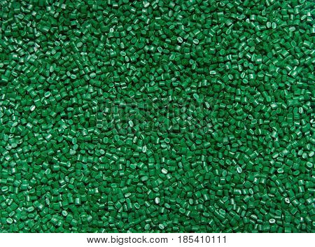 The Plastic Granules. Polymeric Dye Green For The Background . Dye For Plastics In Granules .